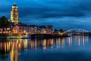 Фотография Голландия Реки Мост Дома Речные суда Вечер Башни Deventer Города