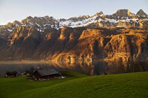 Фотография Швейцария Горы Озеро Дома Снеге Альп Glarus Природа