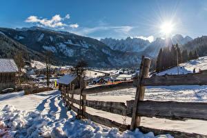 Картинки Австрия Горы Альпы Снеге Забор Солнце Gosau Природа