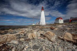Фотографии Канада Камни Маяк Облака Pointe-au-Père Lighthouse Природа