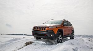 Картинки Jeep Зимние Снег Оранжевые Внедорожник Cherokee Trailhawk, 2015