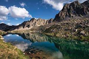 Обои Гора Озеро Камень Облачно Lake Pessons, Andorra Природа