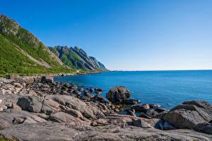 Картинка Норвегия Побережье Лофотенские острова Камень Небо