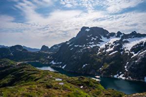 Картинки Норвегия Лофотенские острова Горы Озеро Снега Облачно Природа