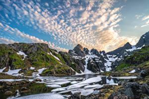 Фото Норвегия Лофотенские острова Гора Камни Небо Снег Облачно