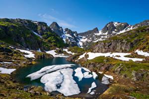 Картинки Норвегия Горы Лофотенские острова Озеро Снега Природа