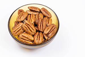 Фотография Орехи Белый фон Миска pecan Продукты питания