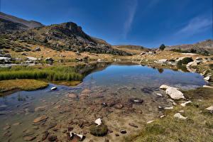 Обои Испания Горы Камни Озеро Pyrenees, Catalonia Природа