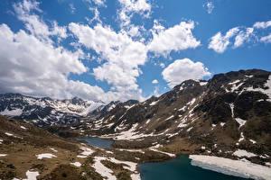 Картинки Андорра Горы Озеро Небо Облака Снег Tristaina Lakes