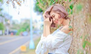 Фото Азиаты Боке Улыбка Рука молодые женщины