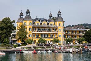 Картинки Австрия Здания Лодки Озеро Набережной Velden, Wörthersee Города