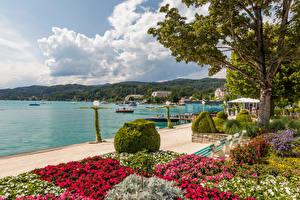 Картинки Австрия Гора Озеро Облачно Набережная Wörthersee Природа
