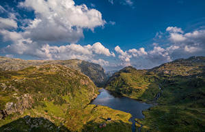 Фотографии Норвегия Гора Небо Утес Облачно Hardangerfjord