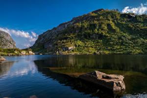 Обои Норвегия Горы Камень Скале Hardangerfjord Природа