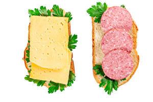 Картинки Бутерброд Хлеб Сыры Колбаса Белым фоном Двое
