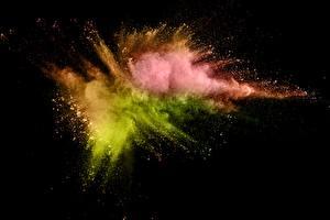 Фотографии Взрывы Черный фон Краски Порошке