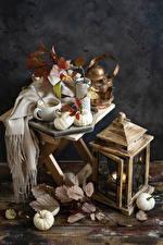 Фото Чайник Свечи Тыква Натюрморт Доски Чашка Ветвь Продукты питания
