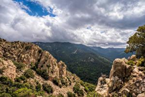 Картинки Испания Гора Облачно Утес Pyrenees, Catalonia Природа