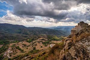 Картинки Испания Горы Камень Облачно Скале Catalonia Природа