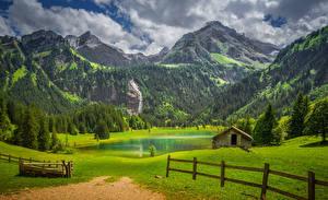 Картинка Швейцария Берн Горы Луга Озеро Леса Альпы Забор Lauenen Природа