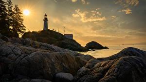 Фотографии Канада Берег Маяк Рассвет и закат Утес Point Atkinson Природа