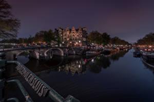 Картинки Голландия Амстердам Мосты Здания Речные суда Водный канал