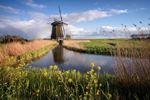 Картинки Нидерланды Мельница Водный канал Облака Природа