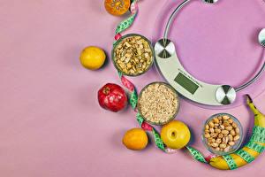 Обои Орехи Яблоки Гранат Лимоны Бананы Овсянка Цветной фон Здоровое питание Измерительная лента Пища