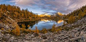 Фотографии Швейцария Гора Осень Камни Озеро Пейзаж Альпы Природа