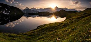 Фото Швейцария Гора Рассвет и закат Озеро Пейзаж Альп Valais Природа