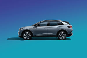 Фотографии Volkswagen Кроссовер Сбоку Цветной фон Серая Металлик ID.4 Crozz Prime, China, 2020 машины