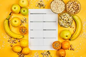 Фото Яблоки Бананы Орехи Лимоны Хурма Овсяная Здоровое питание Цветной фон Календаря