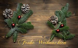 Фотографии Новый год Ветки Шишка Шарики Слово - Надпись Немецкий