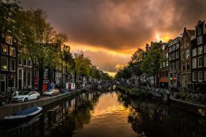 Картинки Голландия Амстердам Дома Вечер Водный канал Набережной Города