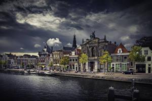 Фотография Голландия Дома Вечер Пристань Водный канал Gemeente Haarlem город