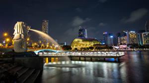 Фотография Сингапур Парки Здания Причалы Скульптуры Ночью Лучи света Merlion Park Города