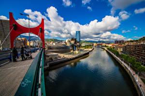 Фото Испания Здания Мосты Речка Облака Bilbao город