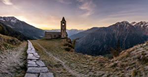 Фото Швейцария Горы Церковь Пейзаж Панорама Башня Каменные San Romerio Природа