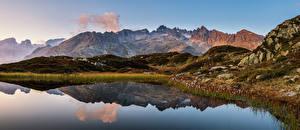 Фотография Швейцария Гора Озеро Альпы Отражении Canton Berne, panorama Природа