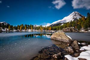 Фото Швейцария Гора Озеро Камни Снеге Льда Альпы Lagh da Saoseo Природа