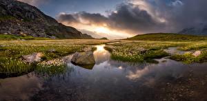 Картинка Швейцария Гора Пейзаж Камень Альп Облака eriophorum Природа