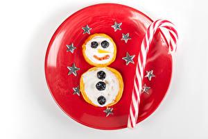 Обои Рождество Блины Леденцы Белый фон Тарелка Снеговика Звездочки Еда