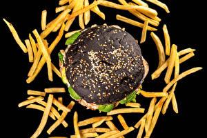 Фото Картофель фри Гамбургер Черный фон Черная