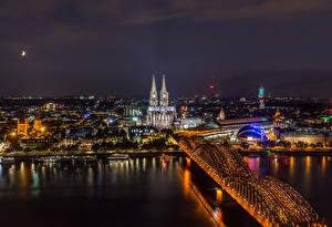 Картинки Германия Кёльн Здания Реки Мост Причалы Ночные город