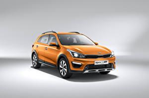 Обои KIA Оранжевые Металлик Кроссовер Rio X-Line, (FB), 2017–20 Автомобили