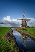 Картинки Нидерланды Водный канал Ветряная мельница Отражение Трава Природа