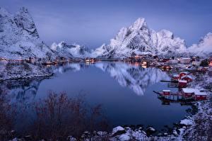 Фотографии Норвегия Зима Гора Лофотенские острова Здания Отражение Фьорд