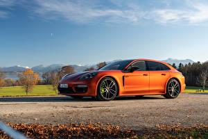 Картинки Порше Оранжевые Металлик Panamera 4 E-Hybrid Sport Turismo SportDesign Package, (971), 2020 автомобиль