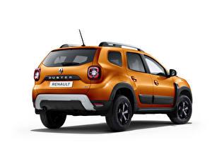 Фотография Рено Оранжевая Металлик Белый фон Duster, CIS-spec, 2021 Автомобили