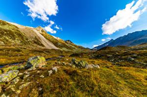 Обои для рабочего стола Швейцария Горы Небо Камни Облачно Траве Graubünden Природа